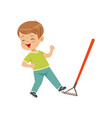 cute little boy stepping on the rake vector image vector image