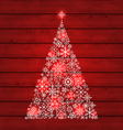 Christmas fir made of snowflakes on wooden vector image vector image