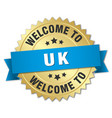 uk 3d gold badge with blue ribbon vector image vector image