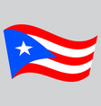 flag of puerto rico waving on gray background vector image vector image