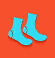 socks sign whitish icon on brick wall as vector image vector image