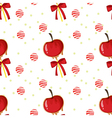 A seamless template with apples candy balls and vector image vector image