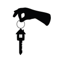 key with house on it and arm vector image vector image