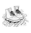 the image of the lace-up shoes on granite paving vector image vector image