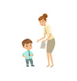 teacher showing bad grades to sad little boy vector image vector image