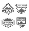 mountains set of four vintage badges vector image
