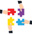hands holding and putting puzzle pieces together vector image