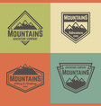mountains four colored vintage badges vector image vector image