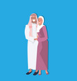 arabic couple standing together wearing vector image vector image