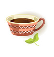 ceramic cup with pattern and black tea inside vector image vector image