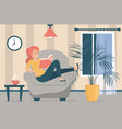 woman reading book sitting in armchair vector image vector image