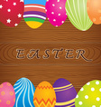 Easter Eggs On Wooden Background vector image vector image