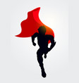 superhero silhouette with cape running forward vector image