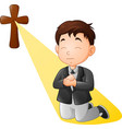 cartoon little boy kneeling while praying vector image