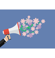 Hand holding megaphone with flowers vector image