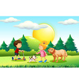 Boy and girl with pets in the park vector image vector image