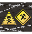Construction yellow sign with barbed wire over