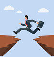 man in business suit jumps from one rocky cliff vector image vector image