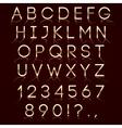 golden alphabet with reflection on dark background vector image