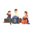 people with hiking backpacks sitting on log in the vector image vector image
