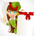 Cute girl the Christmas elf with a banner for text vector image vector image
