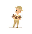 cute little boy in scout costume bringing some vector image vector image