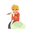 kid boy hugging white goose - flat cartoon vector image