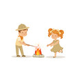 kids in scout costumes near the bonfire boy vector image vector image