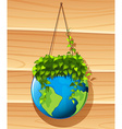 Earth and plant hanging on the wall vector image vector image