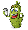 happy pickle cartoon character with mobile phone vector image