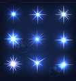 set forms of sparks shining star on a blue vector image vector image