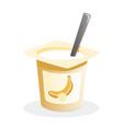 banana yogurt with spoon inside on white vector image vector image