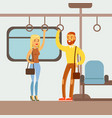 couple standing in the metro train car part of vector image vector image