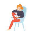 young woman sitting in armchair and reading book vector image vector image