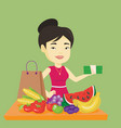woman standing at the table with shopping bag vector image vector image