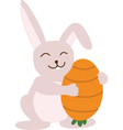 Small lovely rabbit holds egg painted as carrot vector image vector image