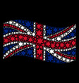 waving british flag pattern of fireworks star vector image