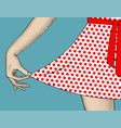 womans hand pull the edge of the polka-dot dres vector image vector image