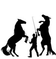 silhouette of a man trainig two horses to rearing vector image