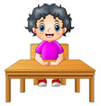 cute little girl sitting at the desk vector image