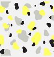 seamless pattern of yellow gray and black spots vector image vector image