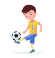 boy soccer player kicking ball on his leg vector image
