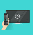 remote control in hand near flat screen tv vector image vector image