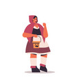 cute girl in costume holding buckets with pumpkins vector image vector image
