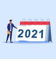 man putting off calendar sheet 2021 year vector image vector image
