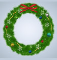 green christmas wreath with ornaments and red vector image vector image