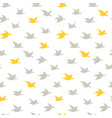 beige and yellow swallow birds seamless pattern vector image vector image