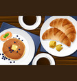 croissants and pancakes on the table vector image