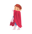 boy in a superhero costume covers his face with a vector image vector image