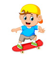 happy boy playing skateboard vector image vector image